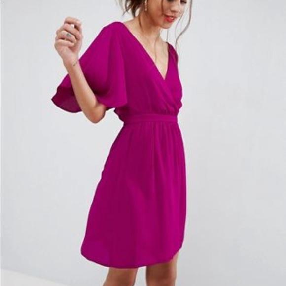 Flutter sleeve cross over mini dress